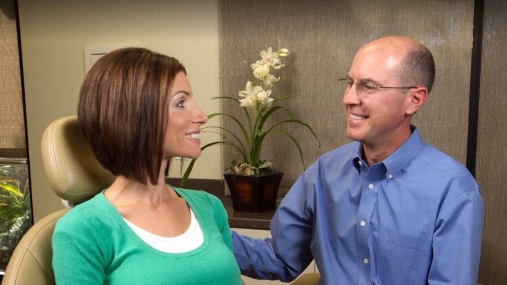 A female patient sitting with James B. Polley, DDS discussing her sedation dentistry option in his Summerlin office.