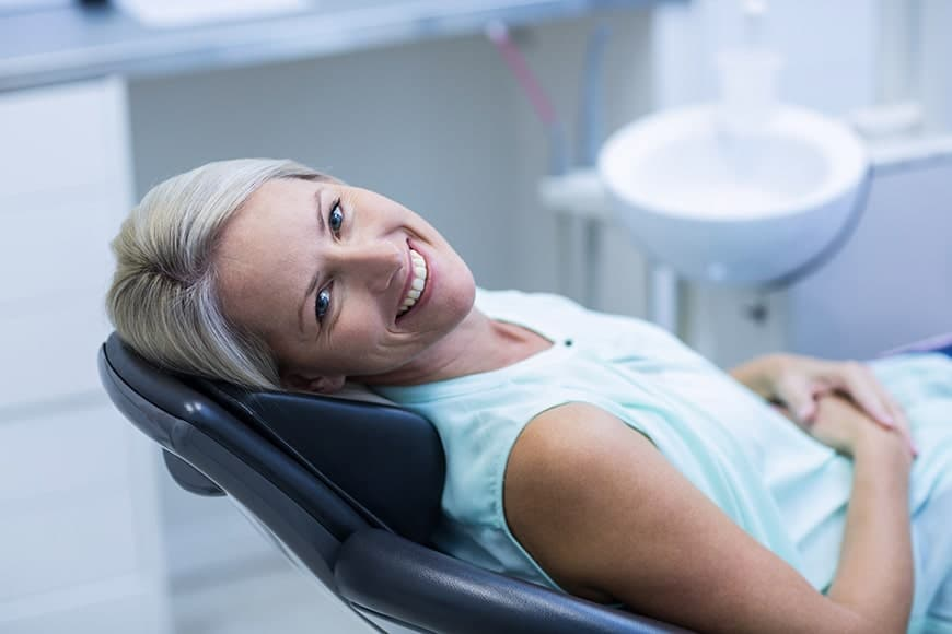 Female dental patient smiling after using sedation to help with her cosemetic dental needs in Las Vegas. While sedation dentistry is mostly known as a treatment for dental anxiety, it can actually be used in many different situations.