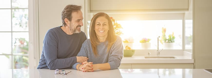 Romantic middle age couple sitting together at home. If you have chipped or otherwise damaged a tooth, the office of Dr. James B. Polley is ready with reconstructive dentistry for all levels of tooth injury, from minor cosmetic problems to teeth that have been badly damaged.