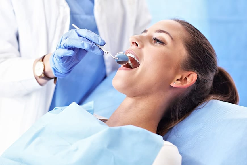 Adult woman having a visit with the dentist to fill a cavity. Cavities are one of the most common medical conditions in the world. In the US, about 96% of adults will develop cavities at some point in their lives.