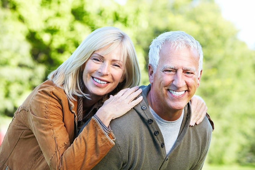 Happy older couple enjoying eachothers company outside. They were looking for alternatives to teeth whitening. James B Polley DDS of Summerlin was able to offer them dental veneers (sometimes called Porcelain Veneers) that gave them the appearance they wanted for their smile.