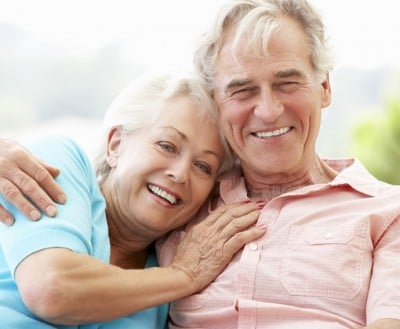 Dental Implants have given this couple the ability to laugh and cuddle together on a couch. This best tooth replacement option gives you a natural feel.