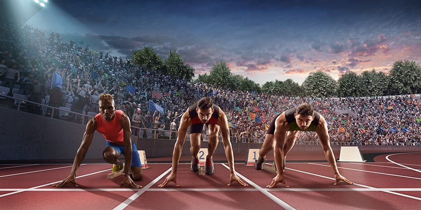 Male athletes at the starting line as they get ready to race - just like a new smile with Invisalign for 2020