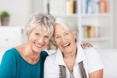 Senior friends laughing and joking with one another