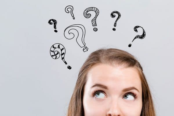 woman with animated question marks over her head