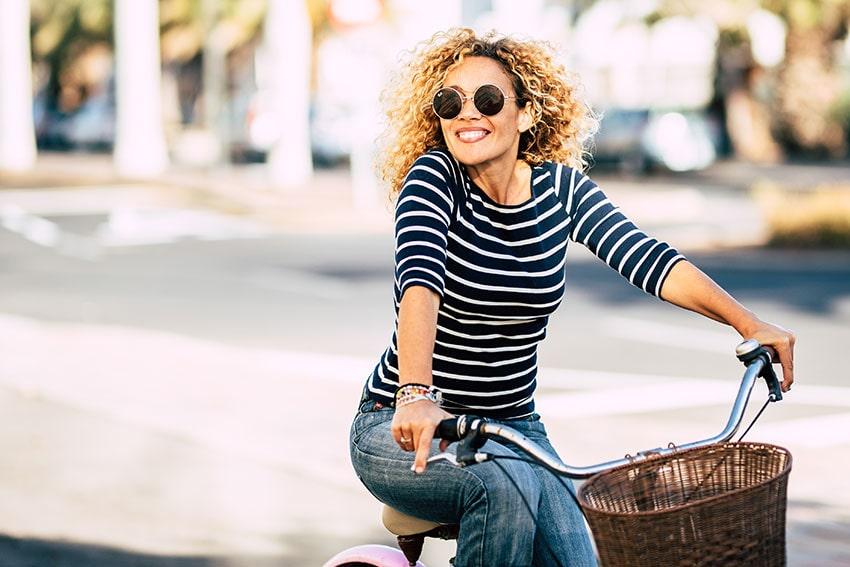 Woman riding bike outside