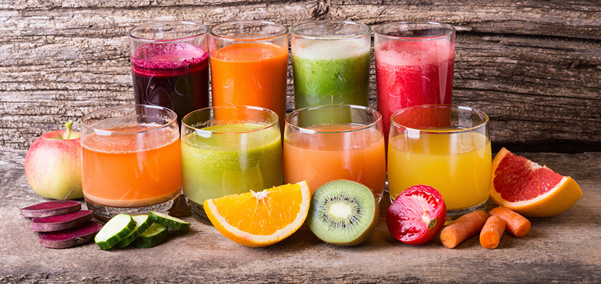 Healthy fruit and vegetable juice on wooden background